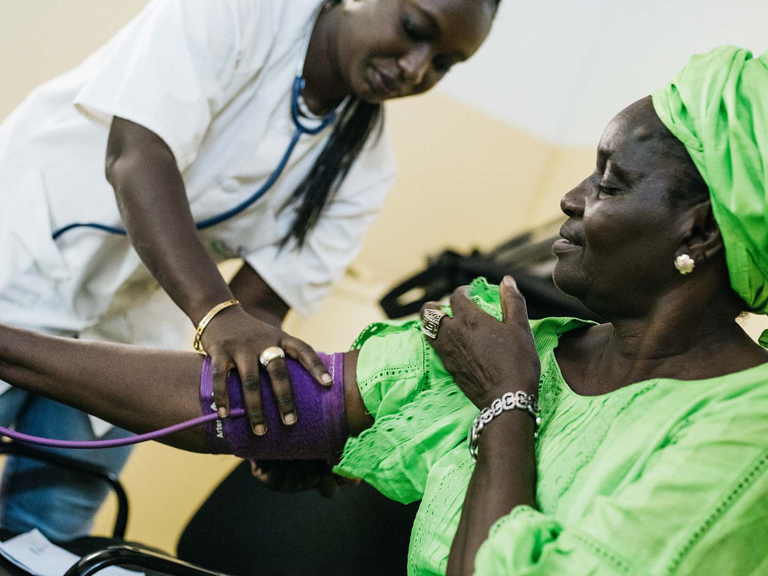 Doctor completing a blood pressure check on a patient