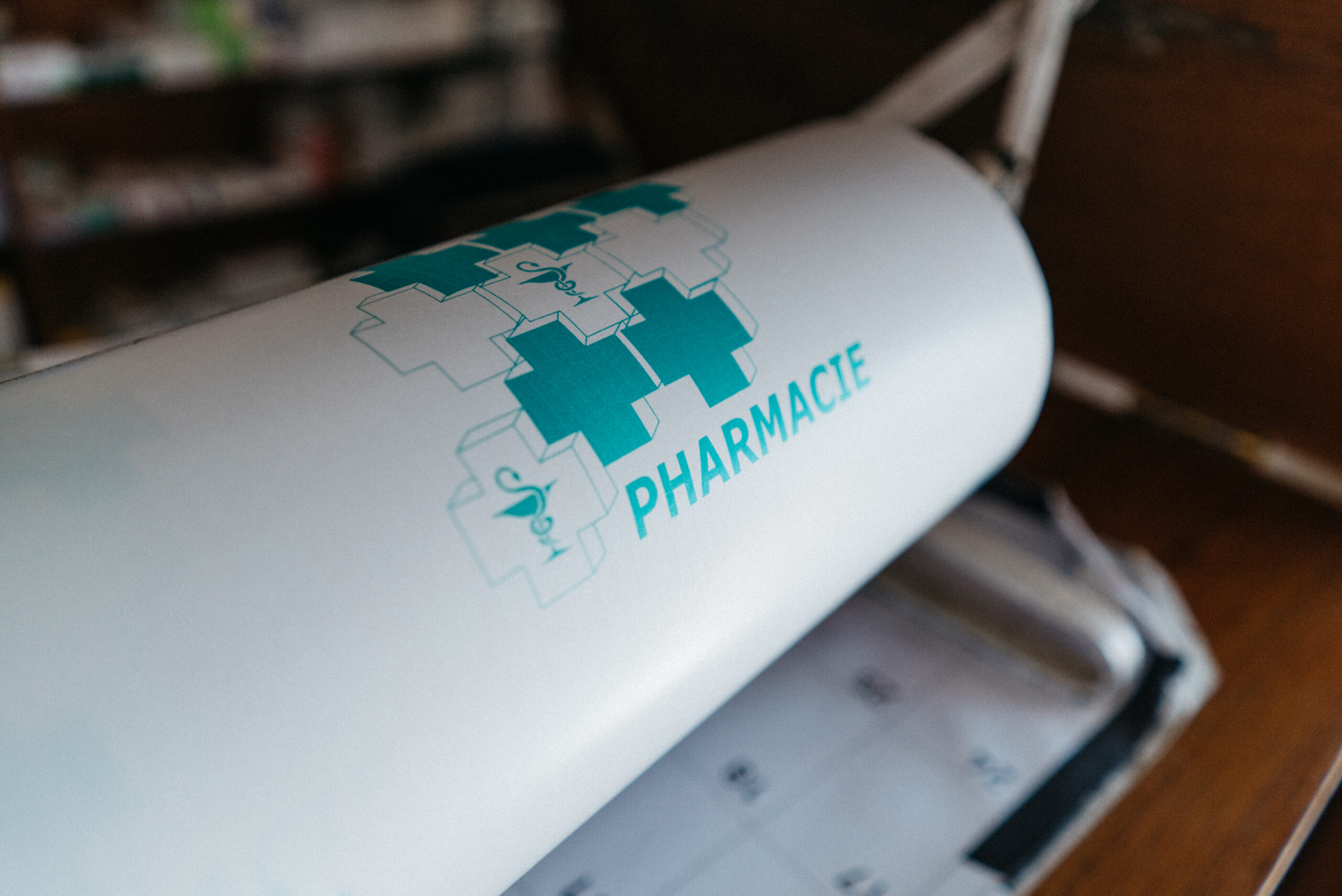 device with pharmacy written on it